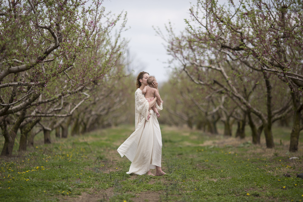 Mom holding baby in peach orchard - SOOC - Kala Rath Photography