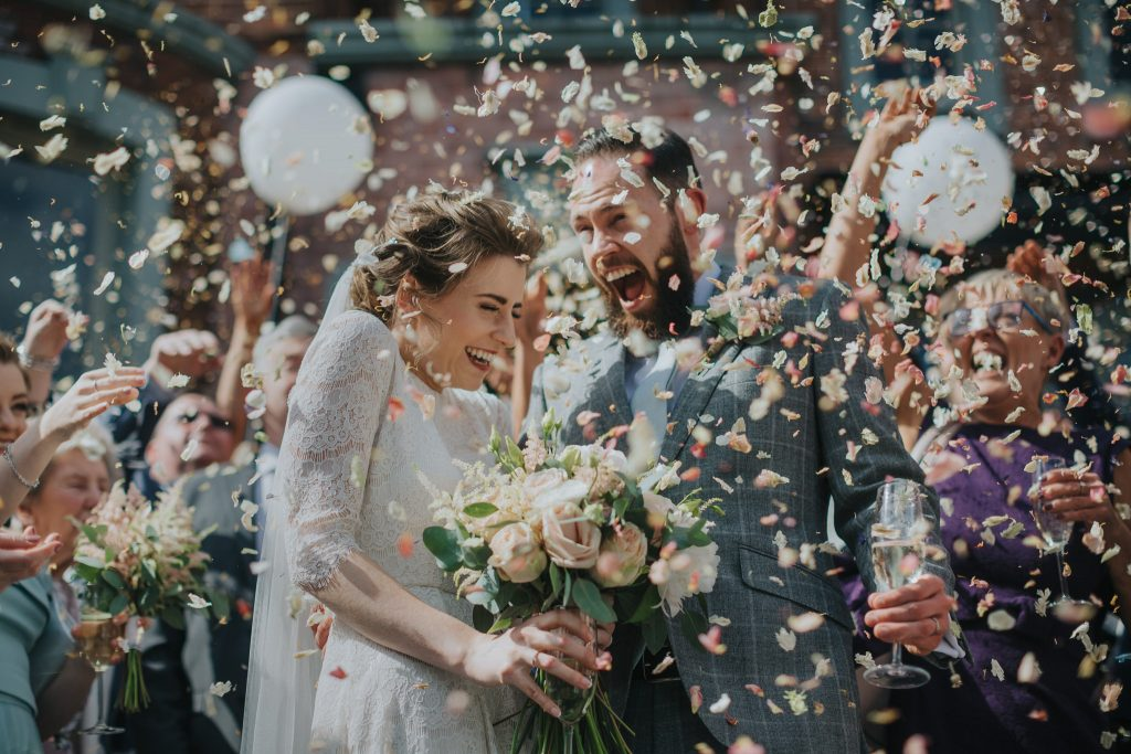 A wedding couple with their awesome confetti exit