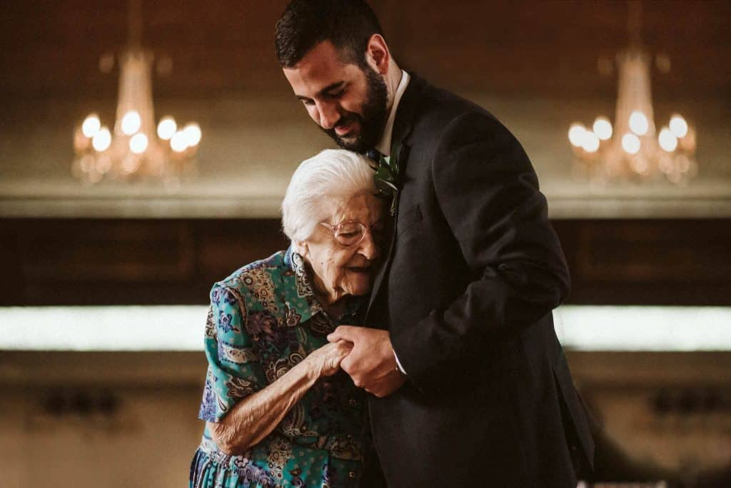 wedding photography moment with groom and grandma