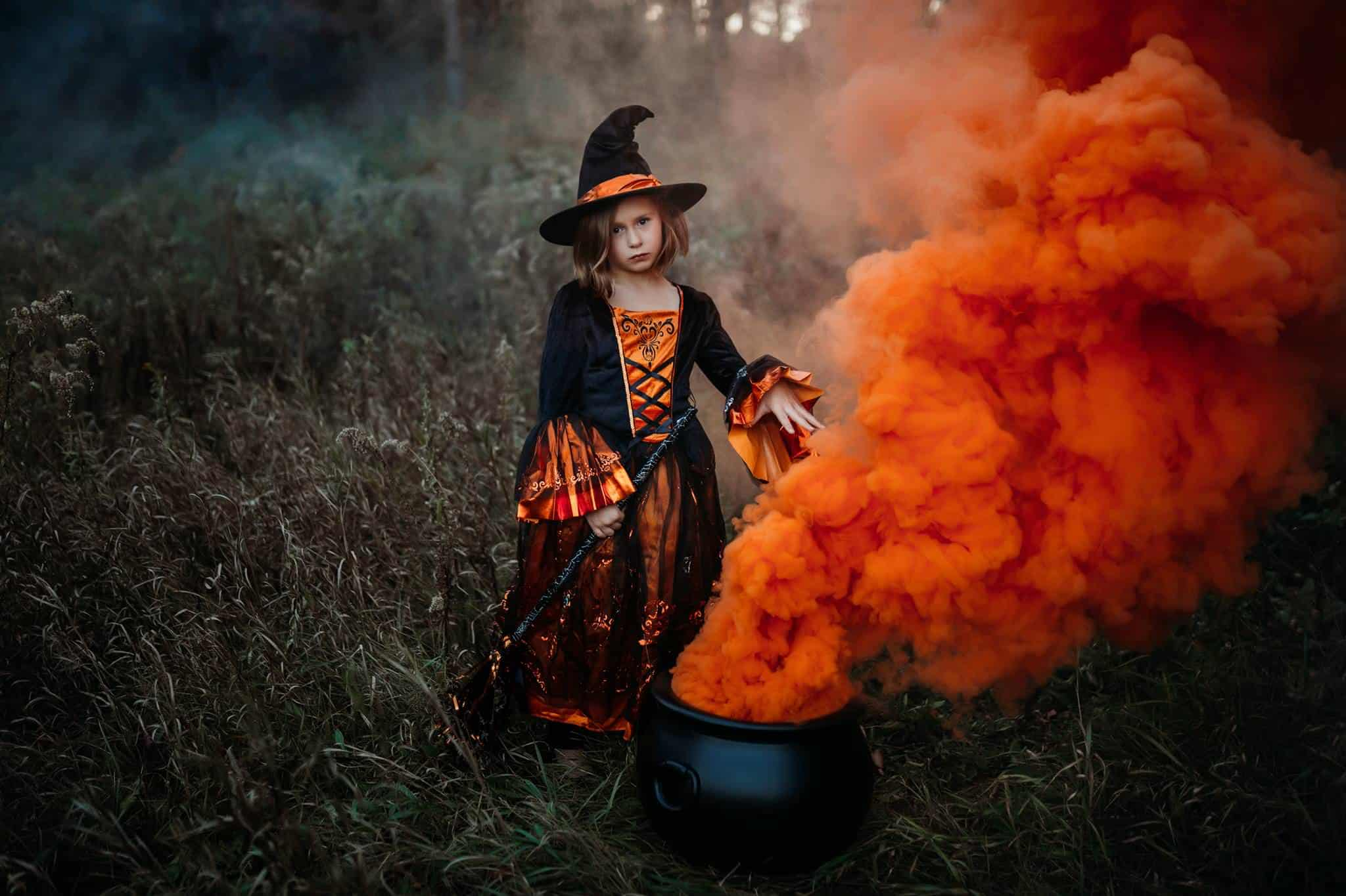 Halloween themed smoke grenade picture of a child in a witch costume