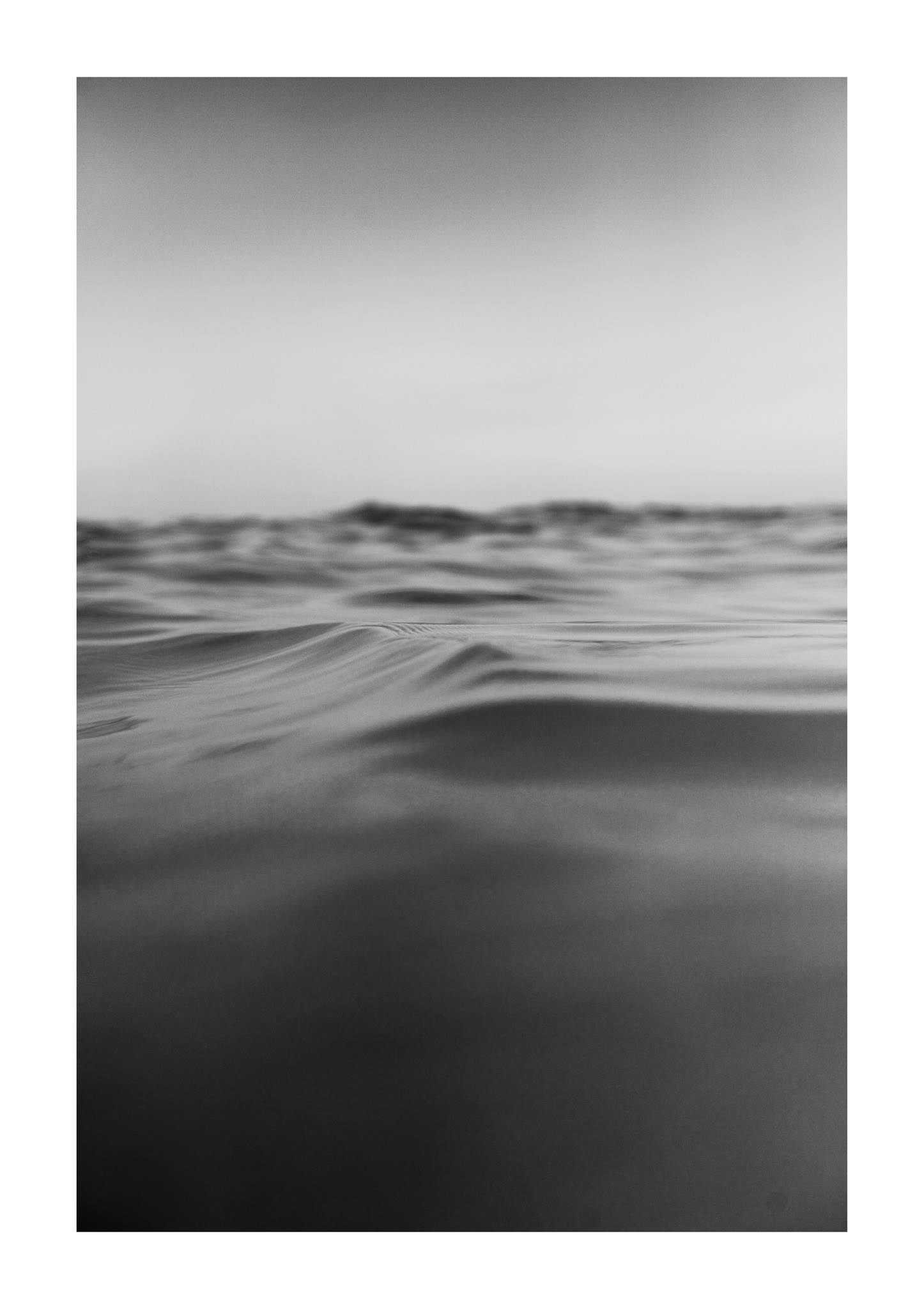 A water surface with small waves passing by