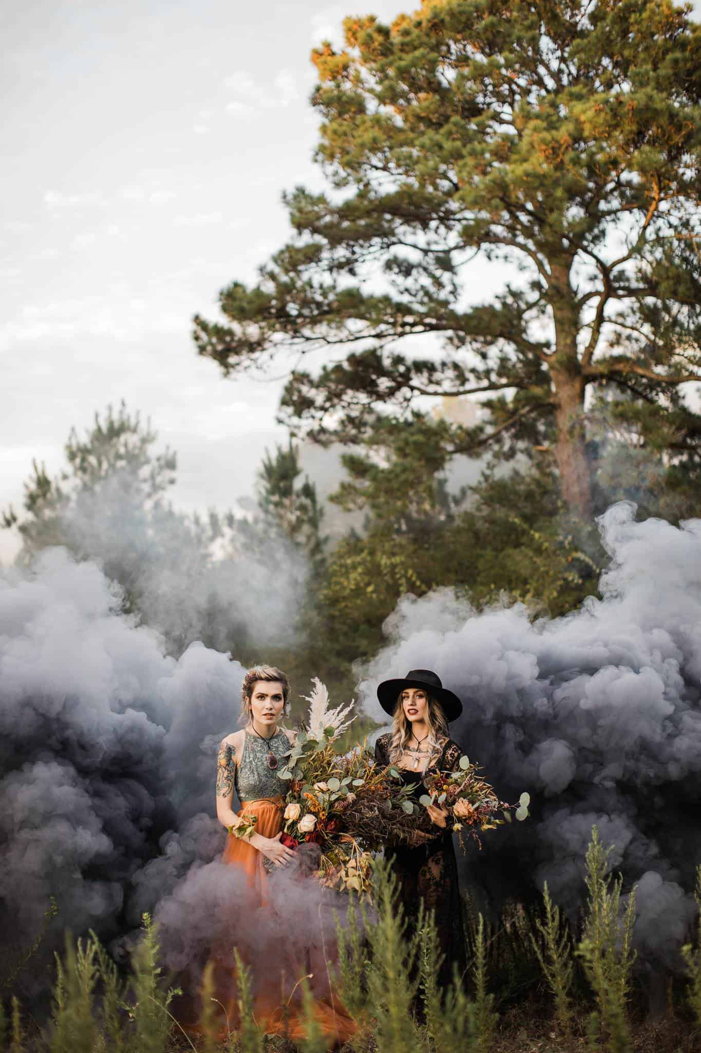 A Creative Photo of two women in a field covered in smoke