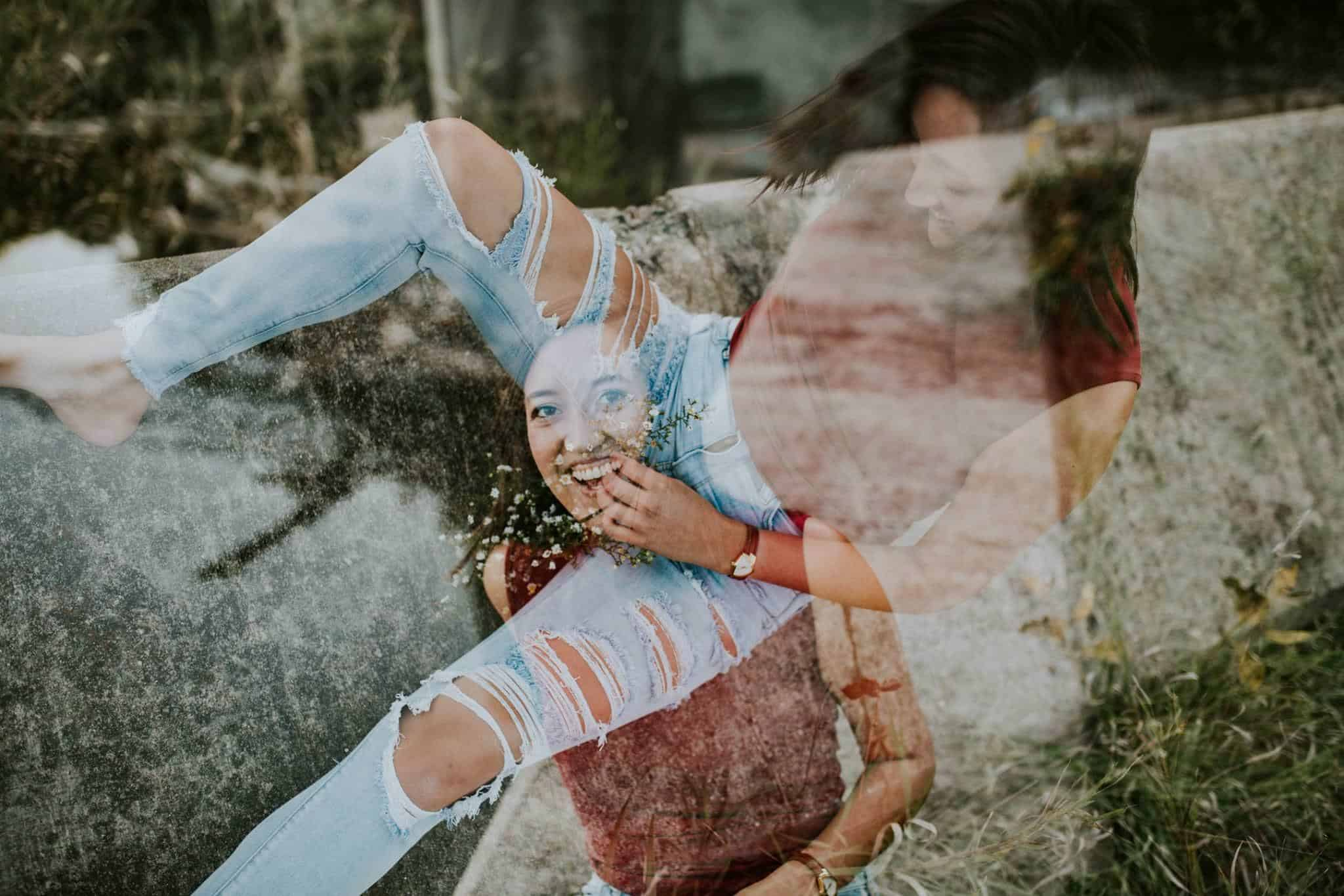 A double exposure photo of a girl went wrong, where she sits on her on face