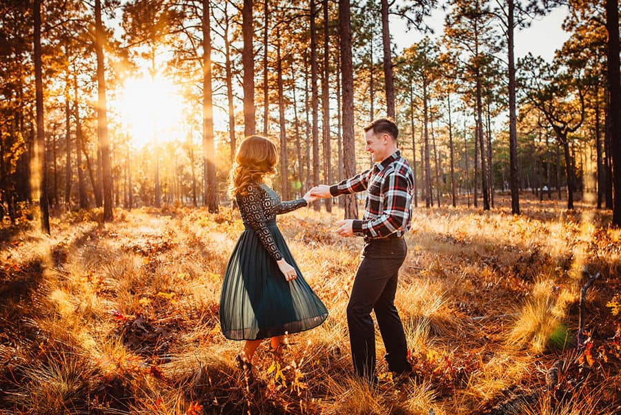 A couple dancing at sunset in a forest