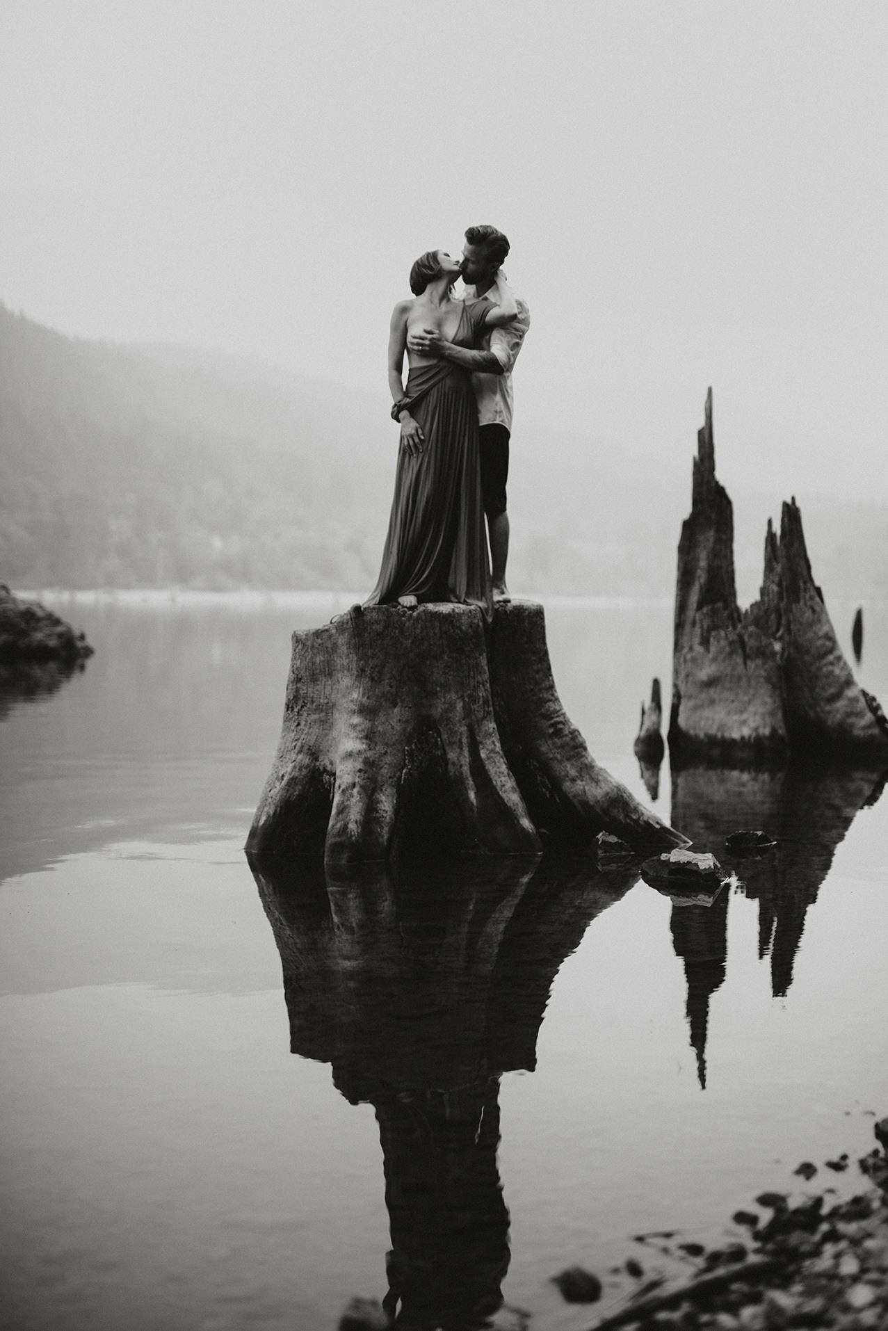 Black and White Photo of a man grabbing a girls boob in the middle of a lake