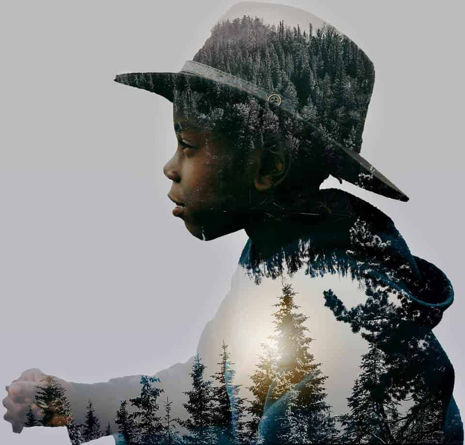 A double exposure portrait of a child with a hat