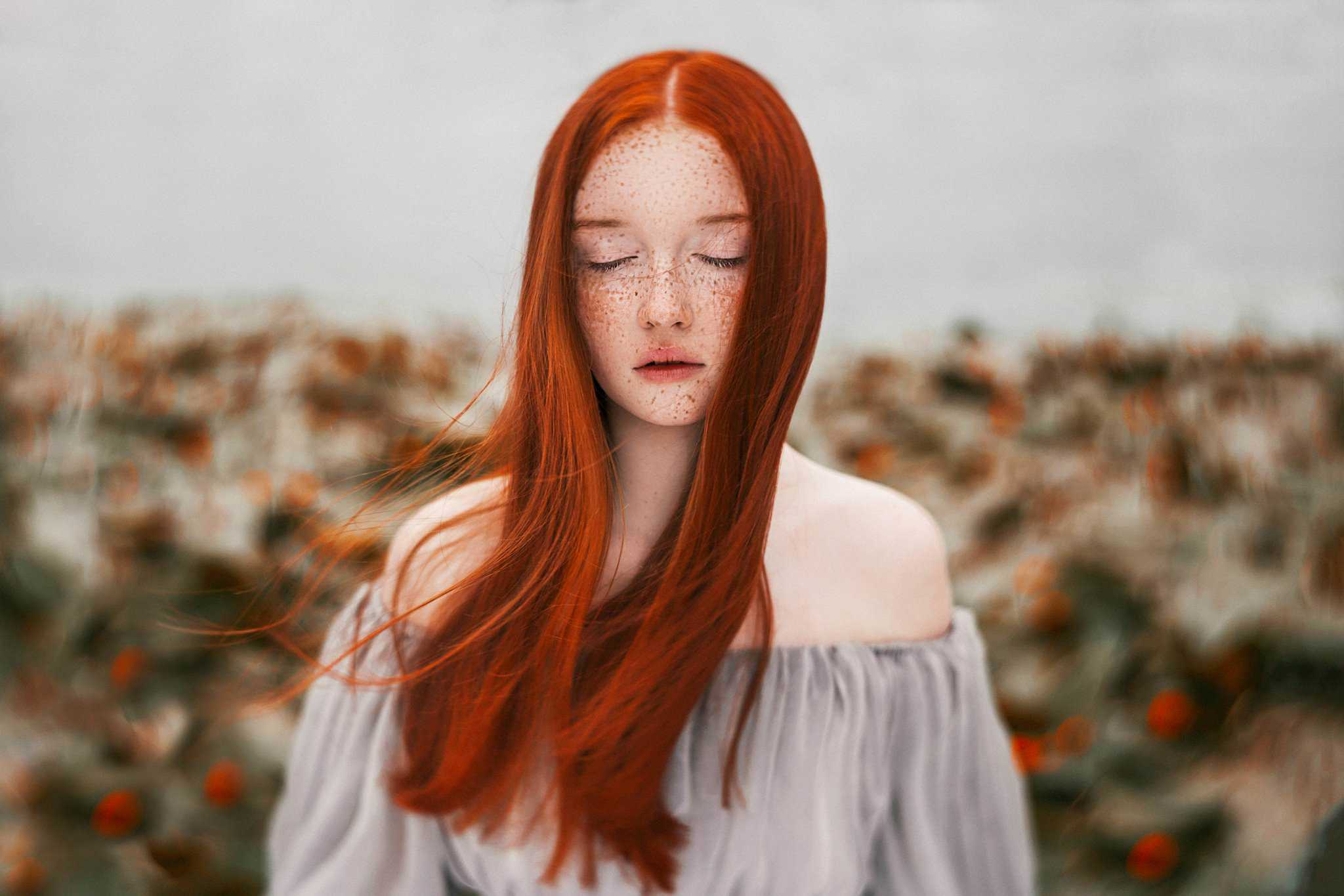 Stunning portrait of a young girl with red hairs