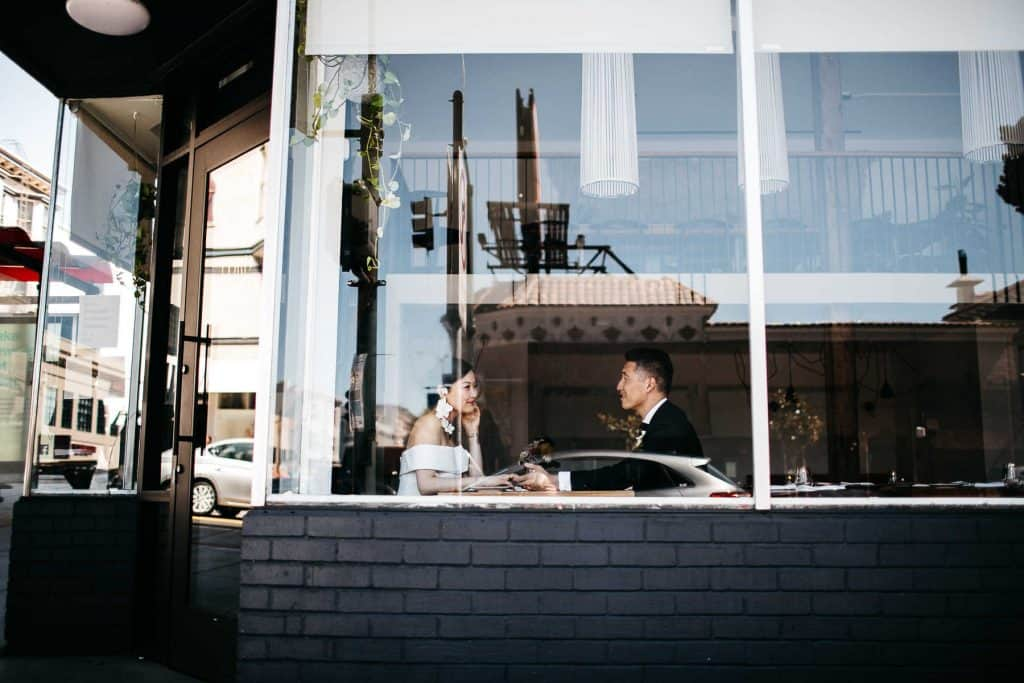 A wedding couple sitting inside the Tartine Factory in San Francisco