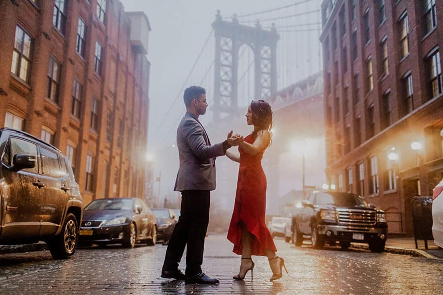A couple dancing on a rainy street in Brooklyn