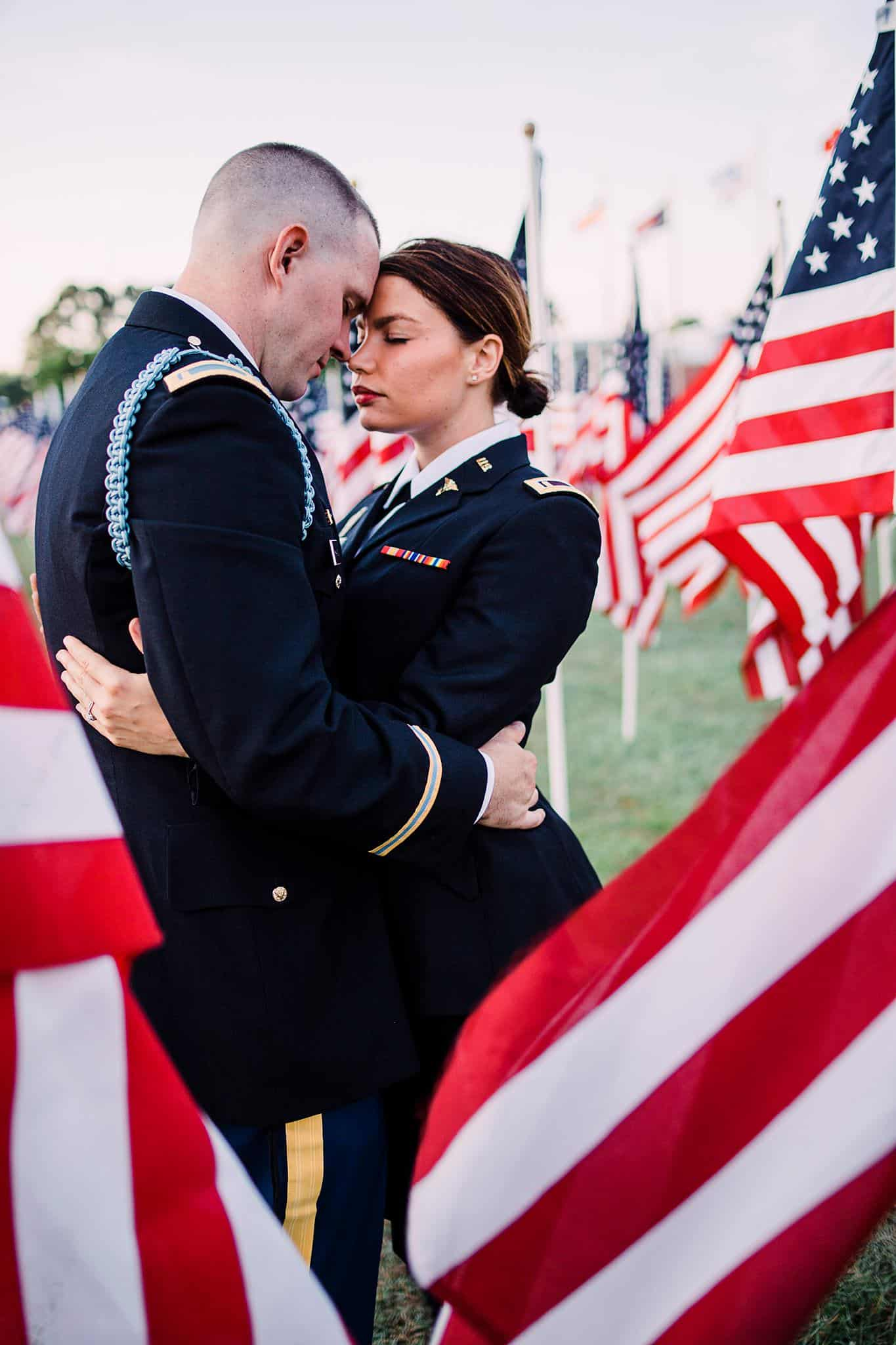 A couple in uniform framed by the US flag