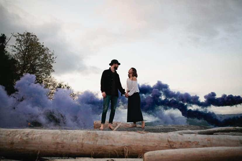 Engagement Photo of a man and a woman on logs