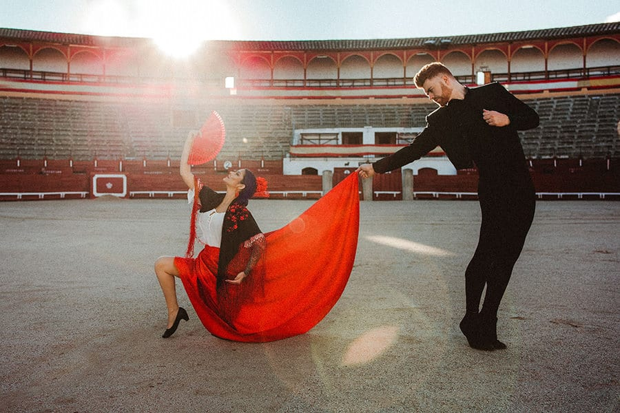 A Spanish couple dancing Flamenco in an arena