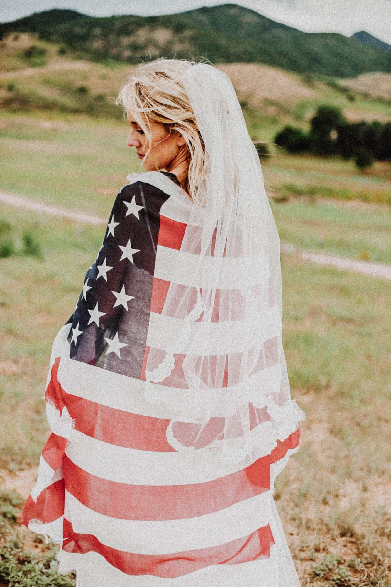A bride covered in the US flag