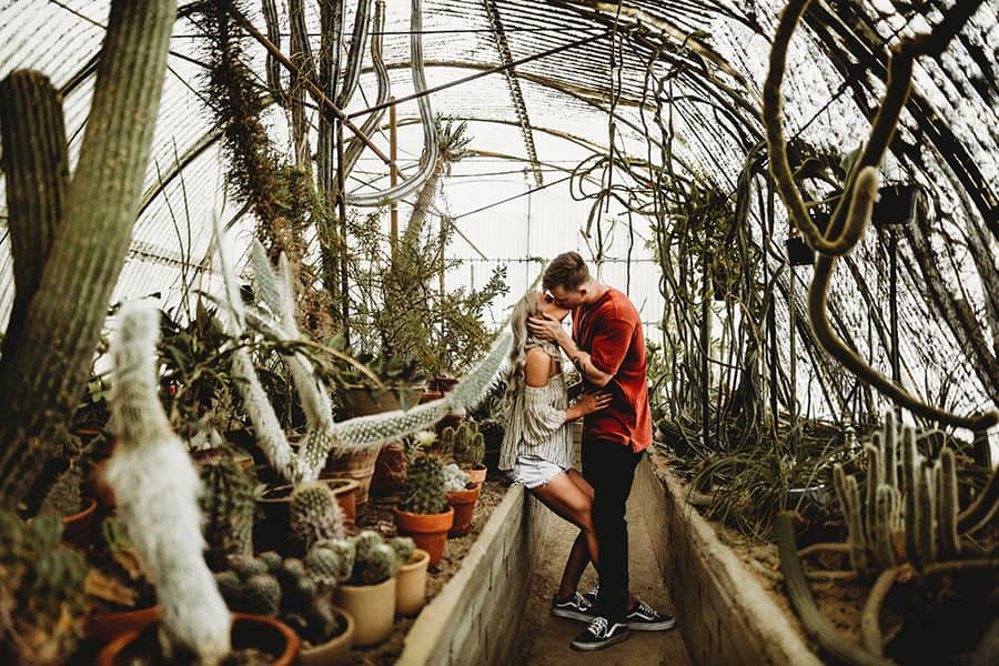 Couple Poses in a greenhouse