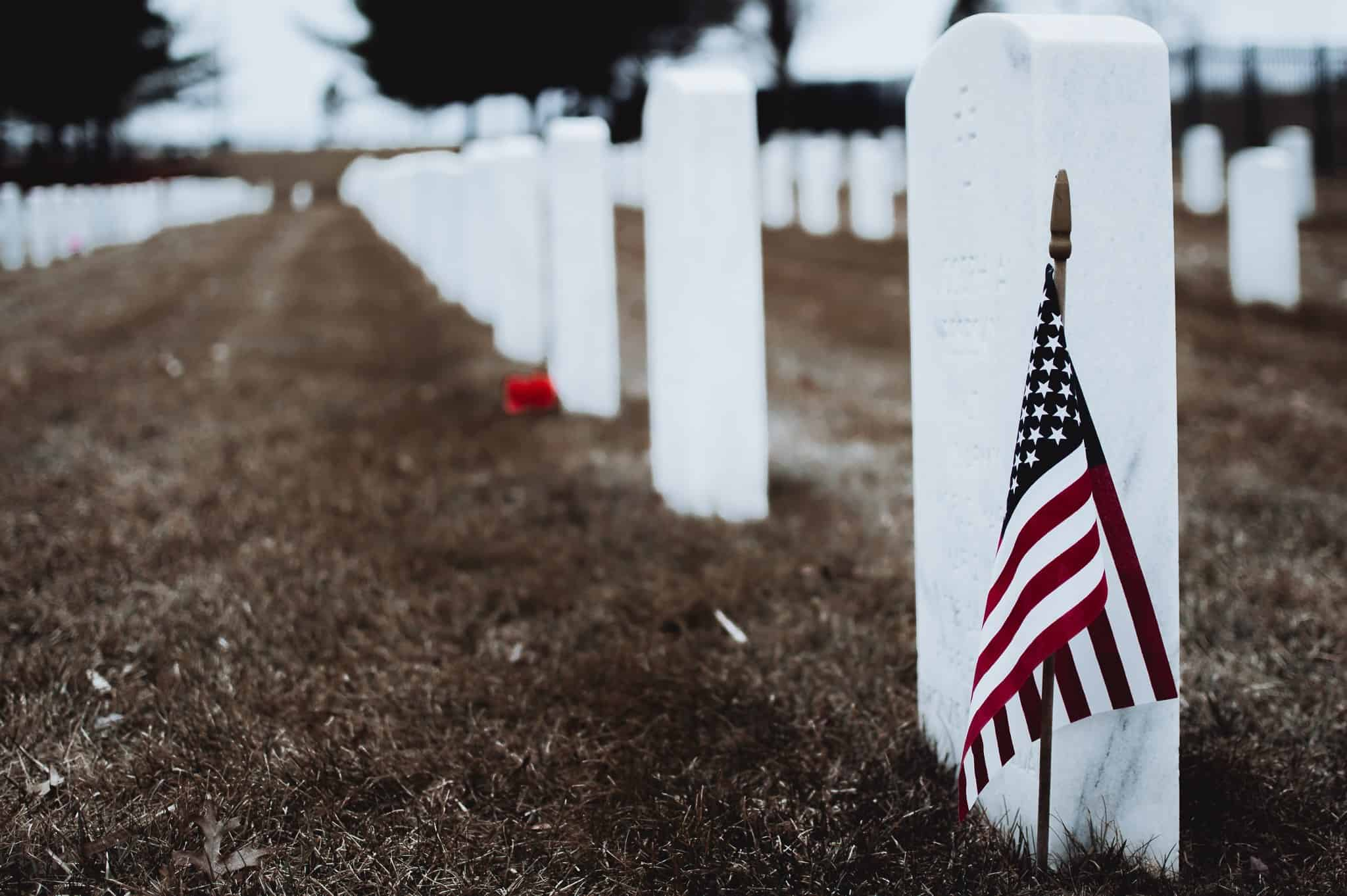 a star spangled banner next to a grave