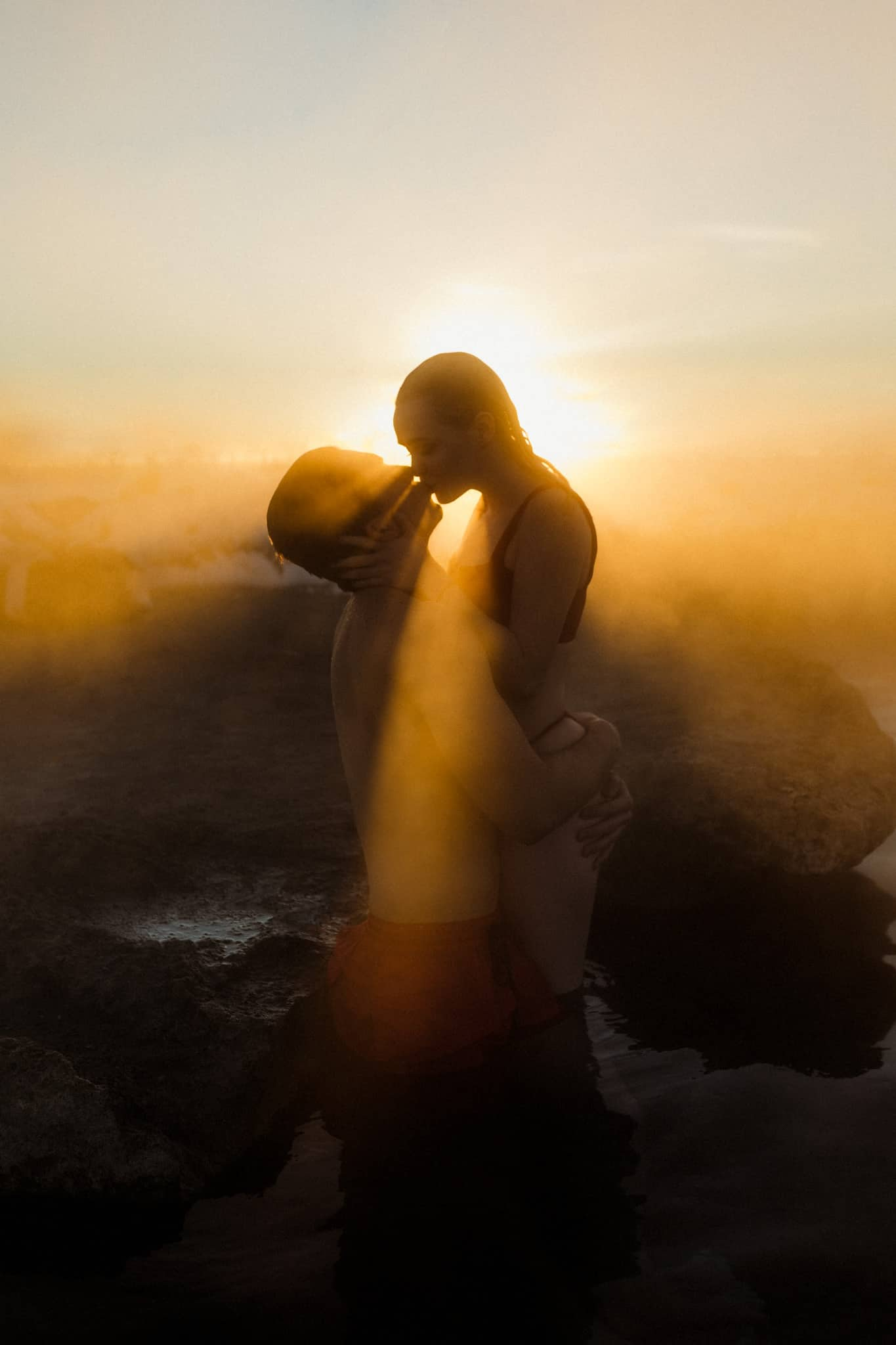 Couple Poses in front of the most epic sunset