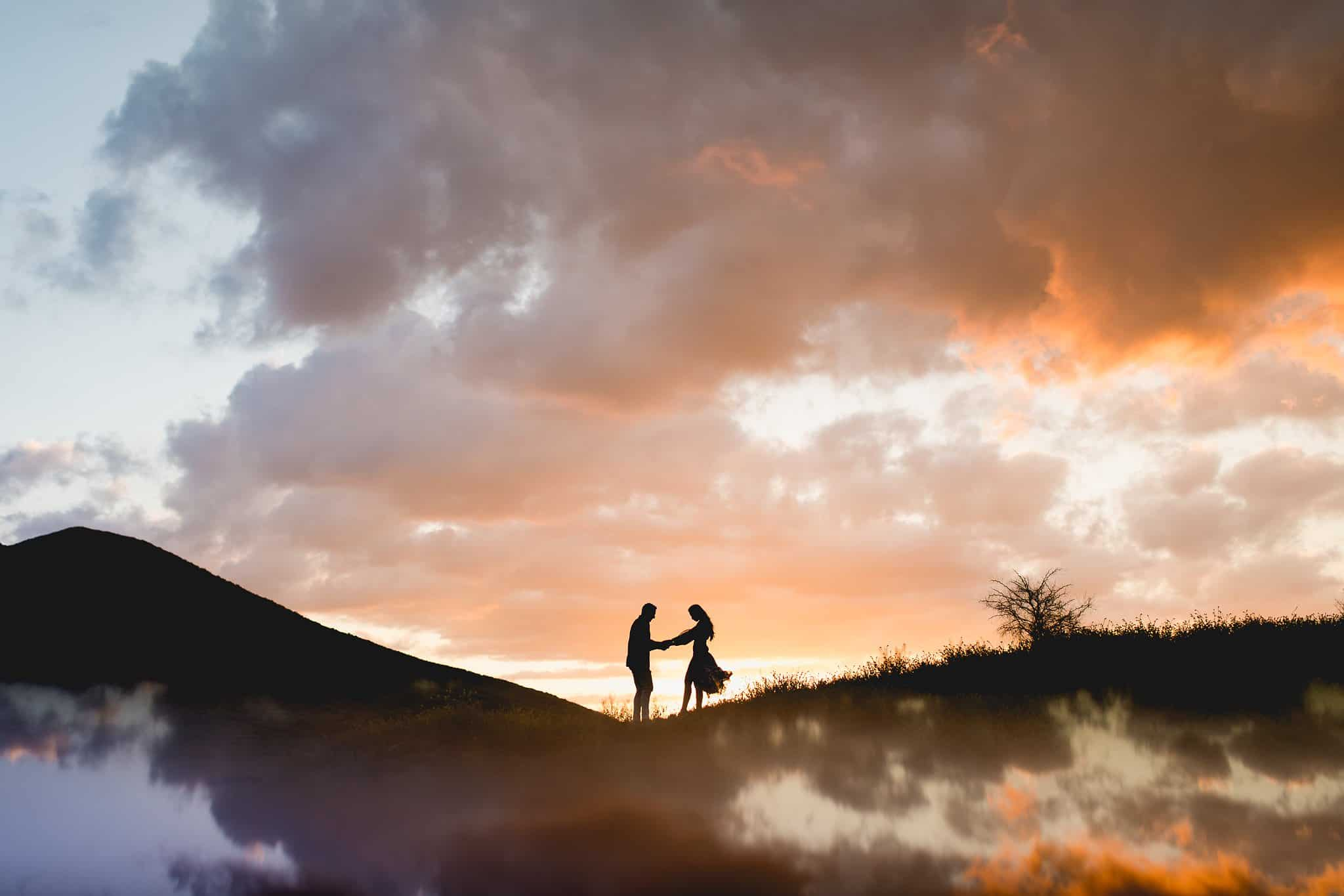 Couple Poses dancing as a silhouette during sunset