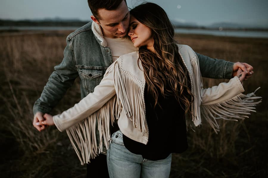 Couple Poses under on a field