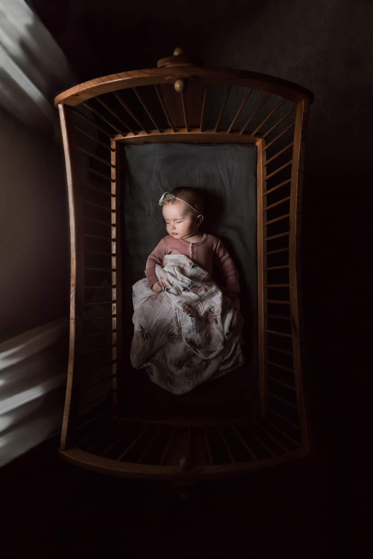 Over the Top photo of a baby in a crib