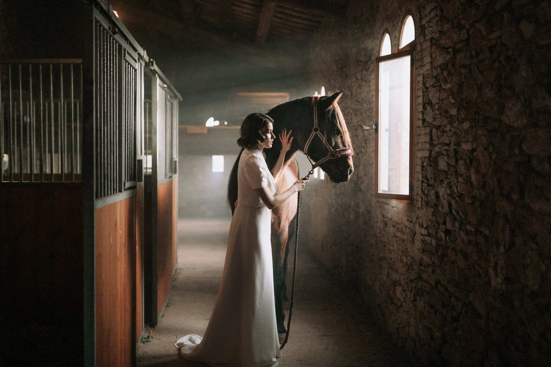 Beautiful Image of a Bride next to a horse