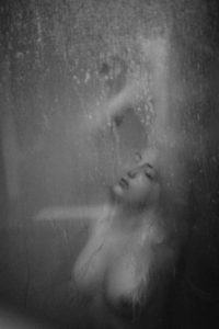 Boudoir Idea with a women in steamy shower scene.