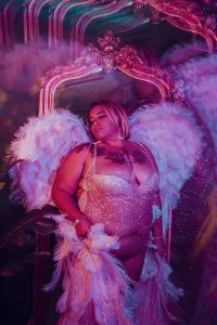 Boudoir ideas for plus sized women in angel wings.