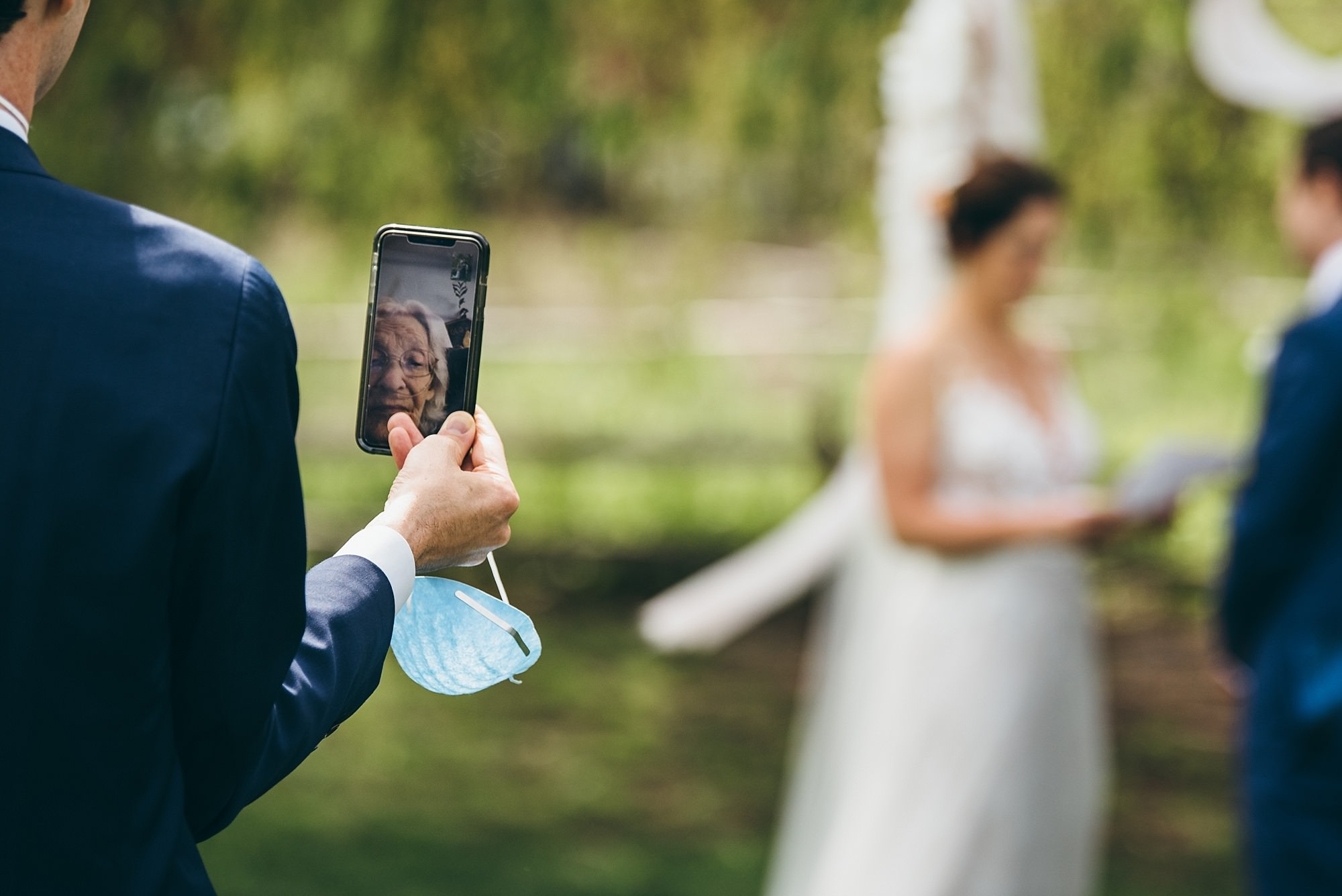A grandmother attends the wedding ceremony via FaceTime
