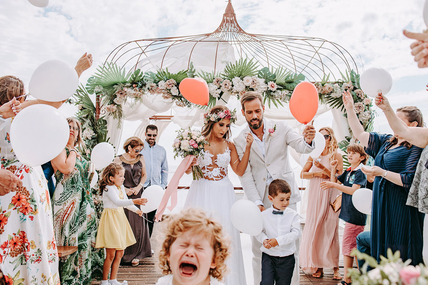 bride and groom walk down the aisle and a flower kid is screaming