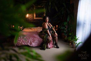 Black Boudoir Photographer portraite of a Black woman on a bed.