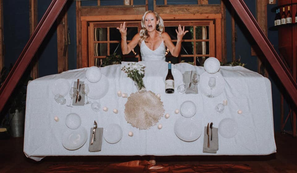 a bride does a table flip on her wedding