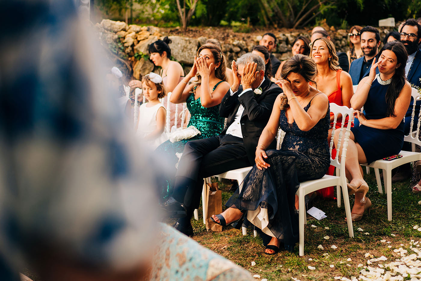 family members of the bride and groom are wiping off their tears during the wedding ceremony