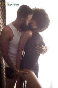 Black Boudoir Photographer posing a couple.
