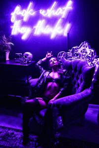 Black Boudoir Photographer showing posing skills and use of unique lighting.