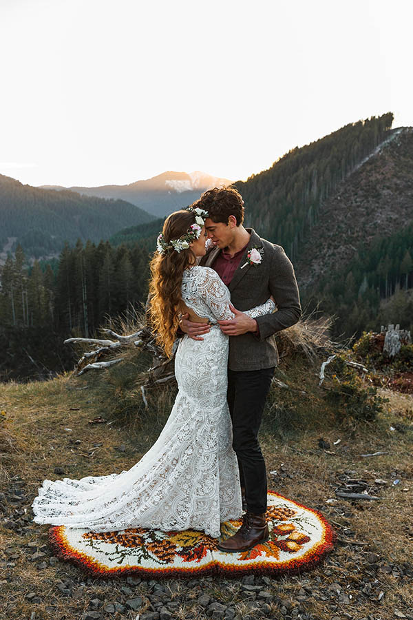 A wedding couple is holding each other and touching each others foreheads whilst standing in the Tillamook National Forest in Oregon.