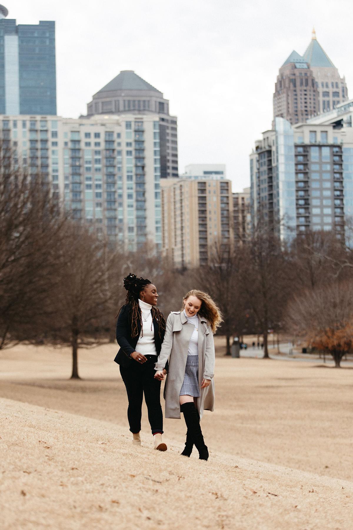 a couple walks through a park in downtown Atlanta