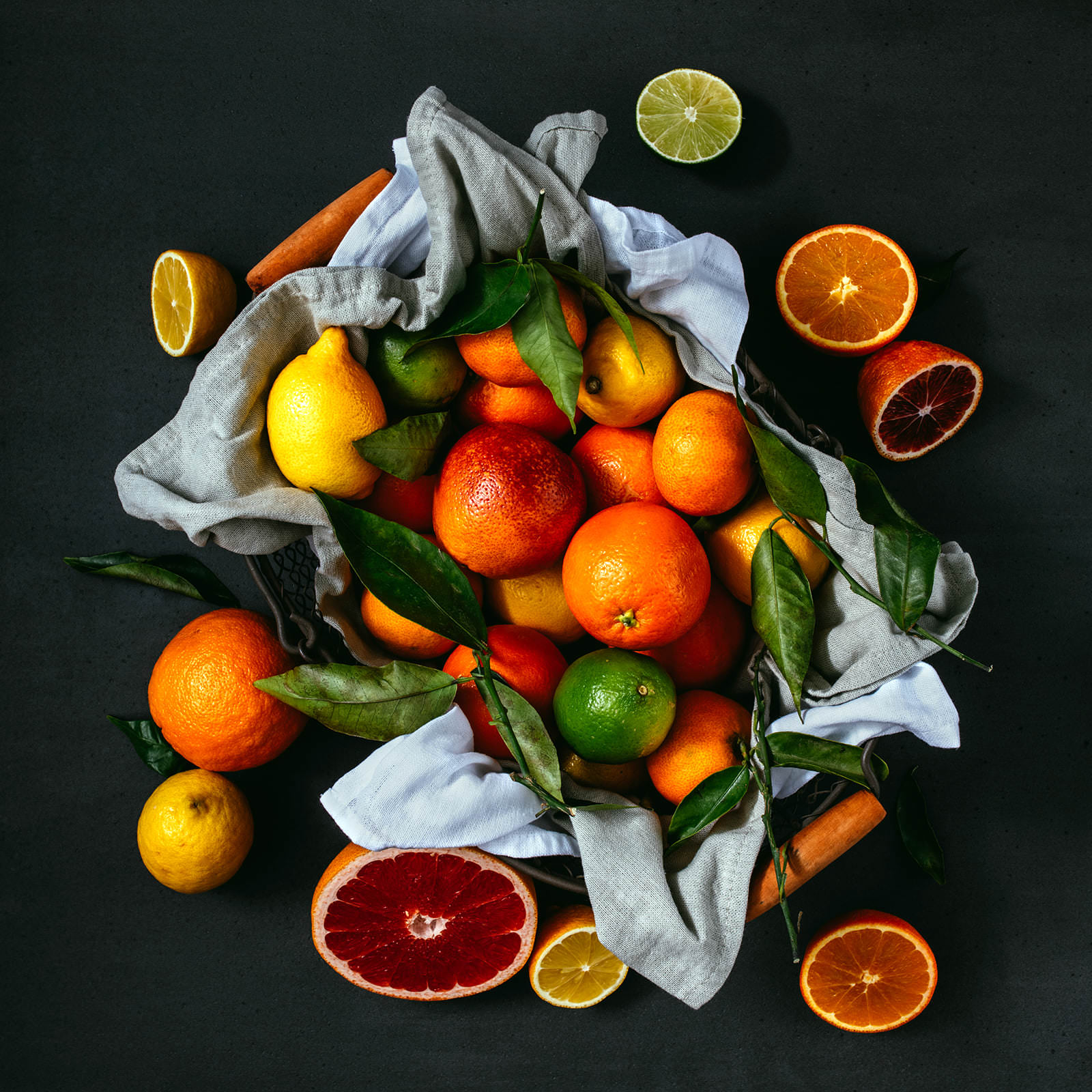 a basket full of fruits like lemonades and oranges photographed from above