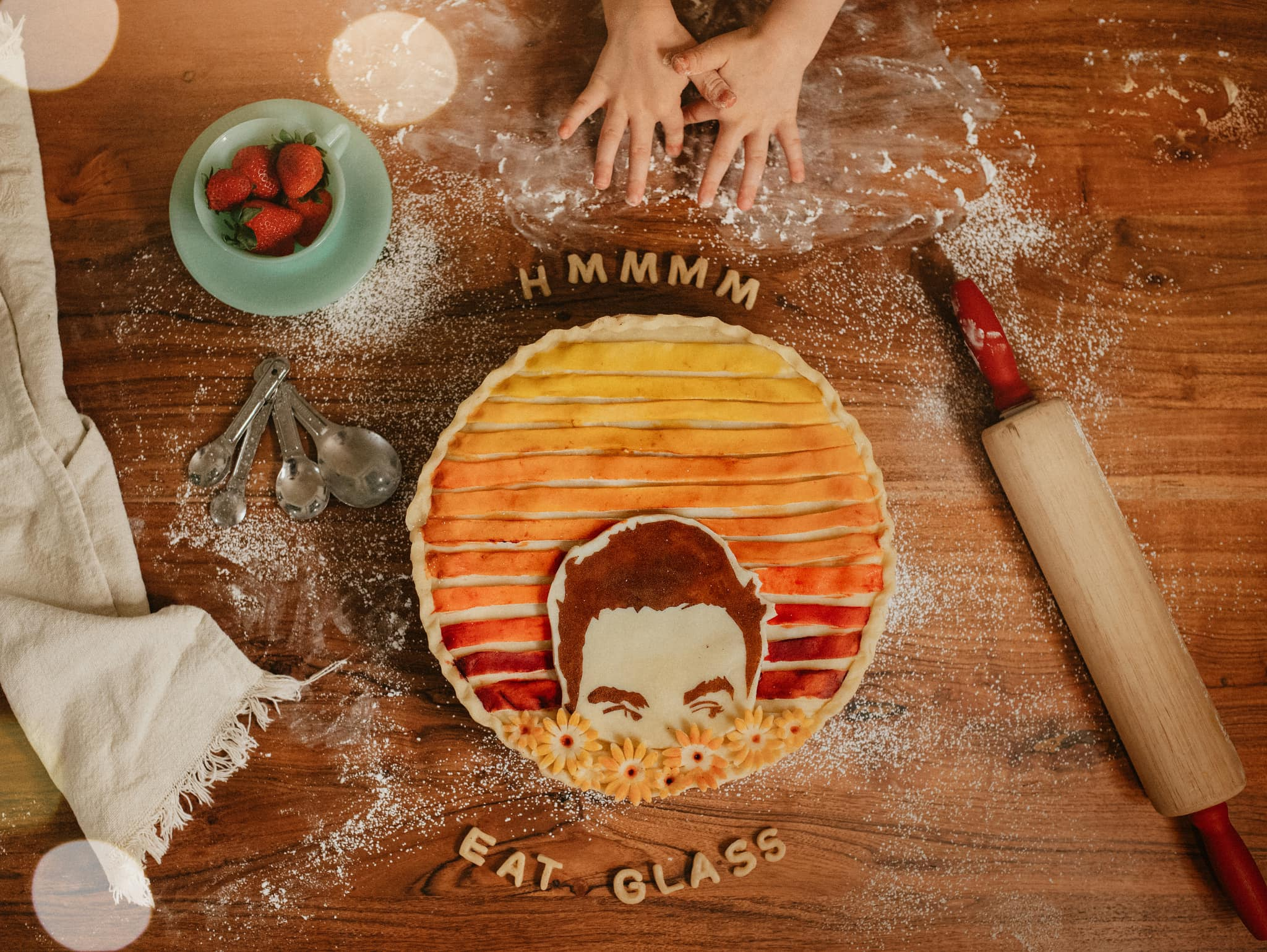 a freshly made pie with the face of one of the actors from schitt's creek on it
