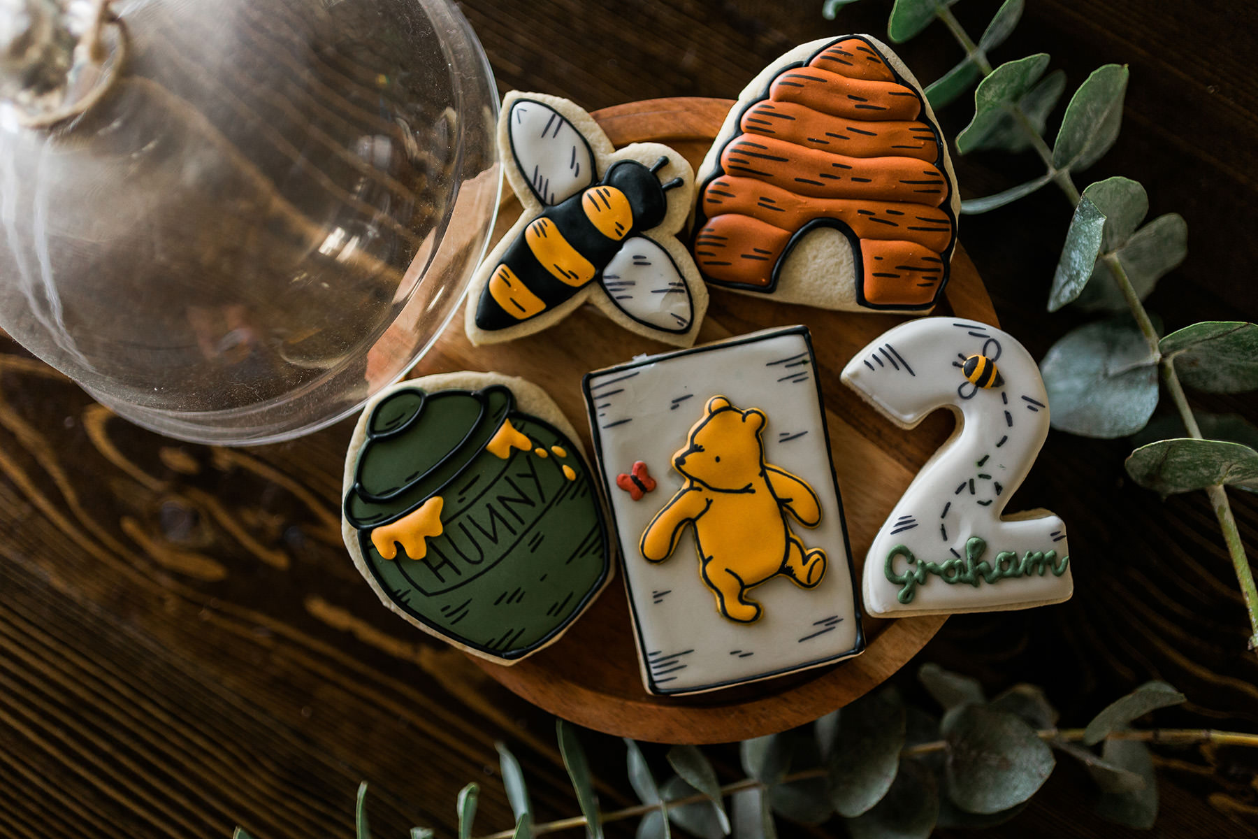 A photo of Winnie Pooh cookies for a boy's second birthday