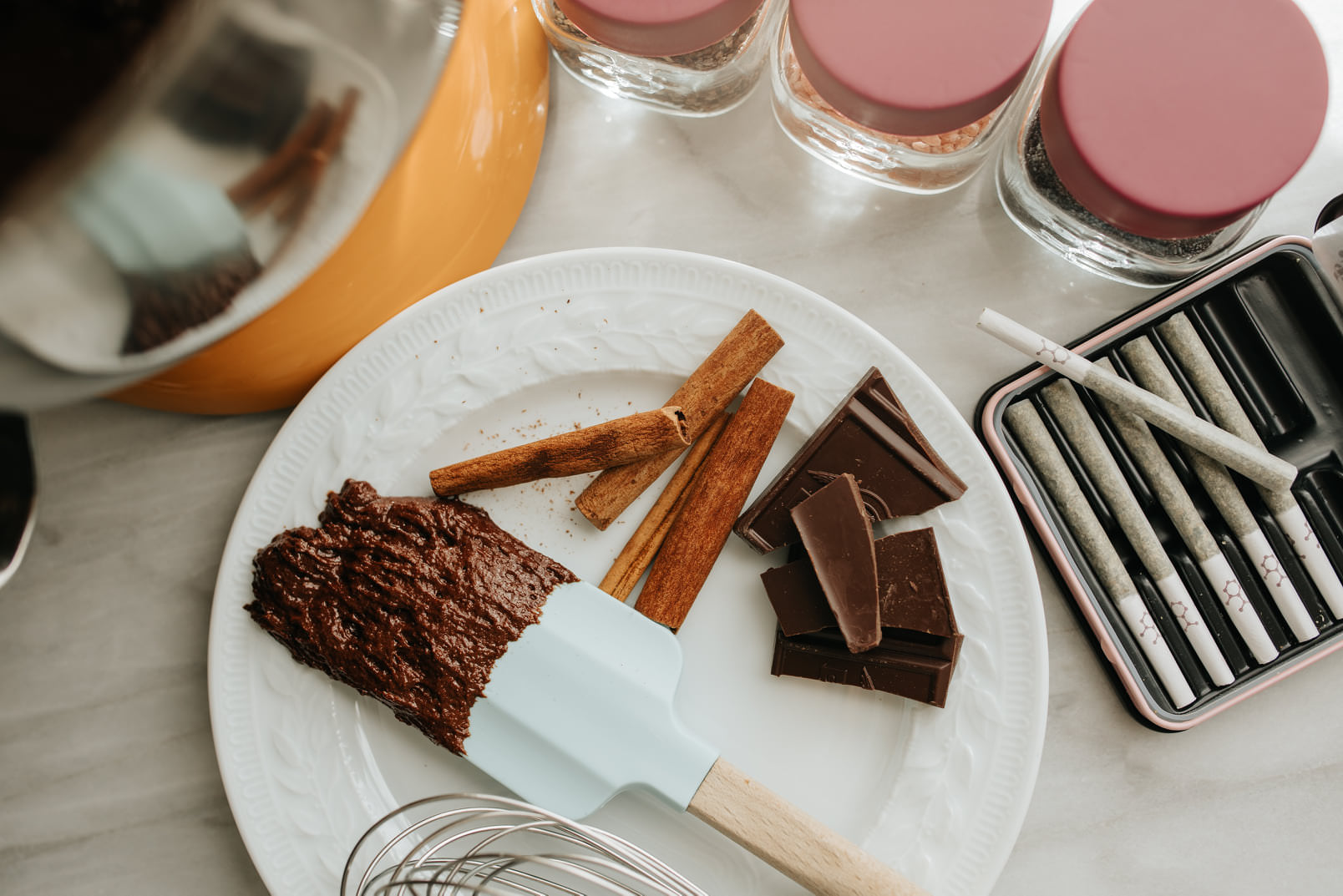 Cinnamon and chocolate pieces lie on a dish