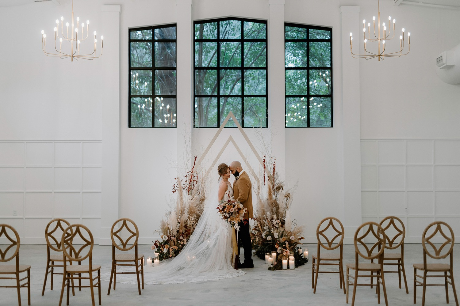 A wedding couple is getting married in the Distillery in one of the North Carolina wedding venues.