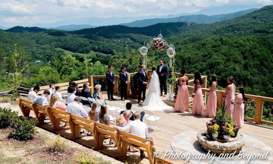 This luxury cabin is located on Sevierville and shows an outdoor wedding on a terrace.