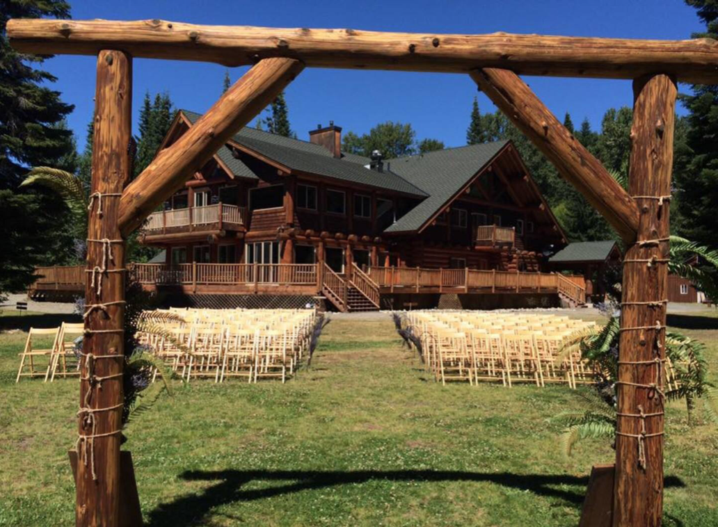 This Cabin Creek Lodge is located on Easton, Washington and features a ceremony setup in front of the house.
