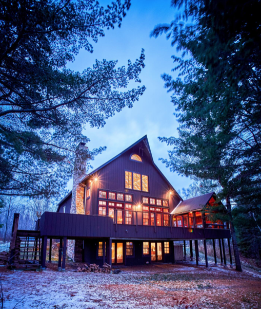 The barn is located in La Pointe, Wisconsin, in a forest.