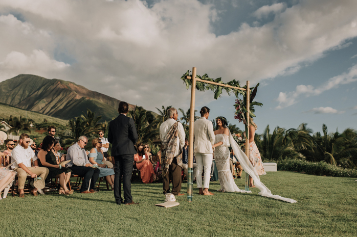 A wedding couple is getting married at the Punakea Palms, one of the Hawaii wedding venues.