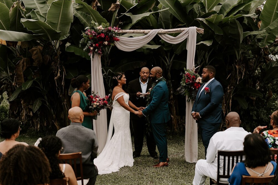 A wedding couple is getting married at the Hhunshower Farm in Hawaii.