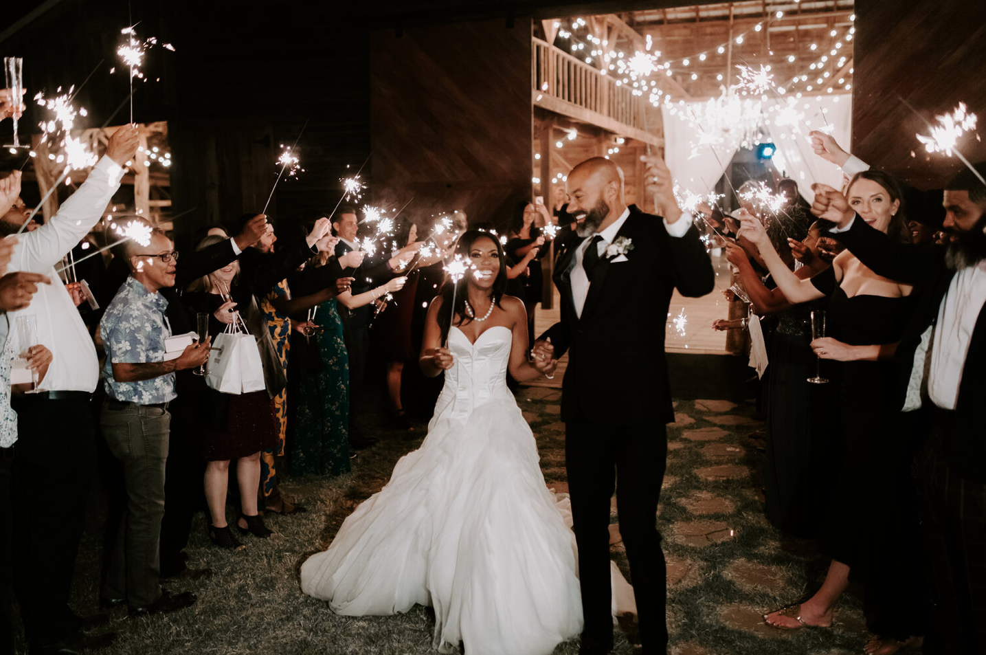 A wedding couple an their guests are celebration at the Barn at the Woodson of the wedding venues in Oklahoma.