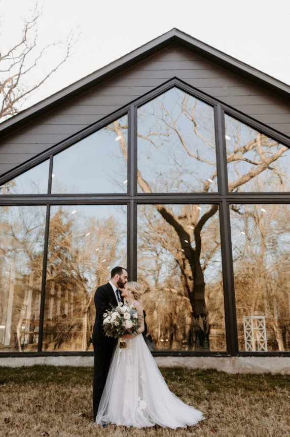 A wedding couple is holding each other at Merrick Hollow in Oklahoma.