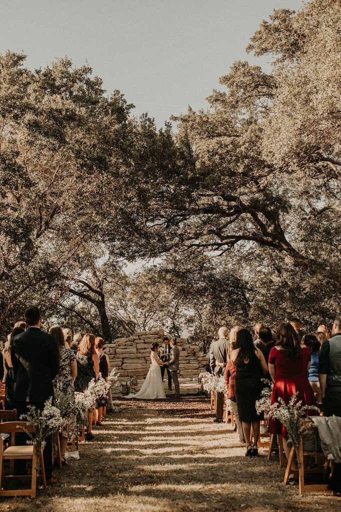 A wedding couple is getting married at the House on the Hill in Austin, Texas.