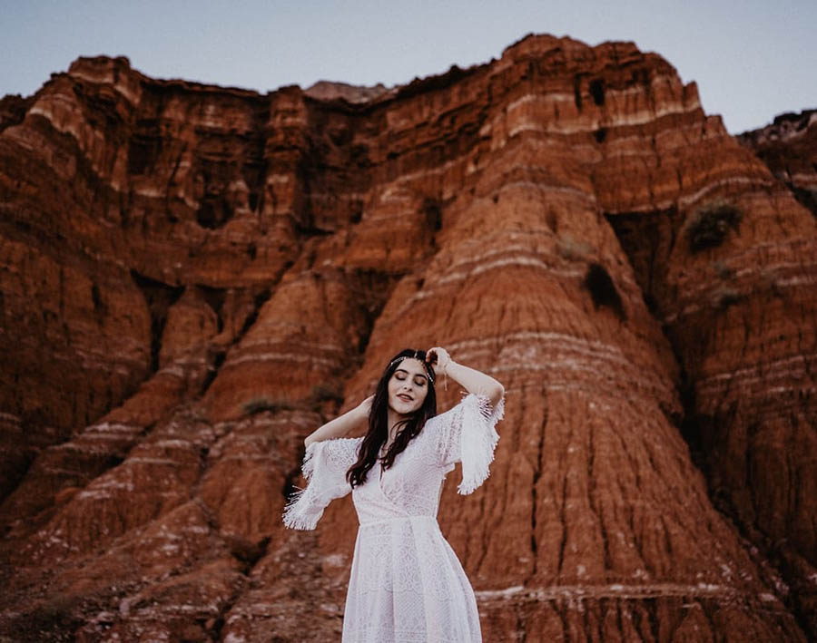 A bride is standing in front of the Palo Euro Canyon in Texas.