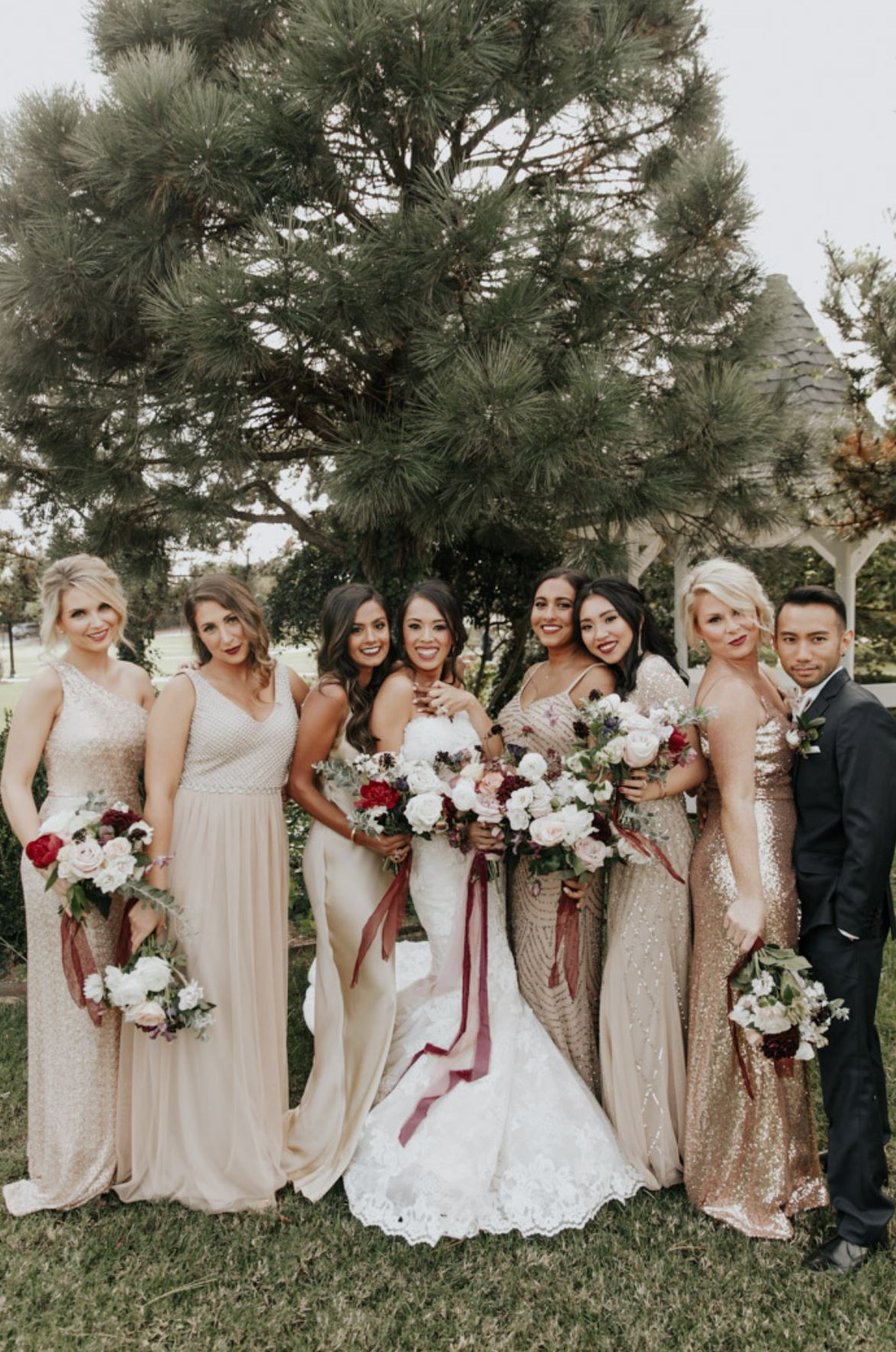 A bride and her bridesmaids are staning at Coles Garden in Oklahoma.